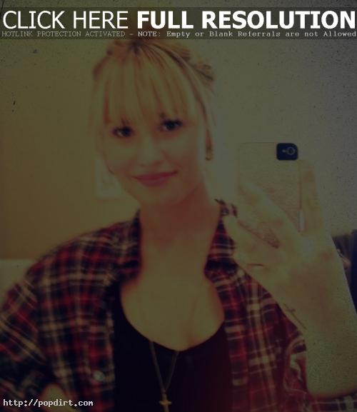 Demi Lovato, seen here blonde with bangs, talks with Z100 about how she can't stand guys who cry, X Factor, Britney Spears and her hit single 'Give Your Heart A Break'