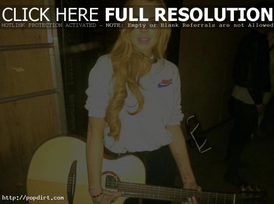Lindsay Lohan and guitar