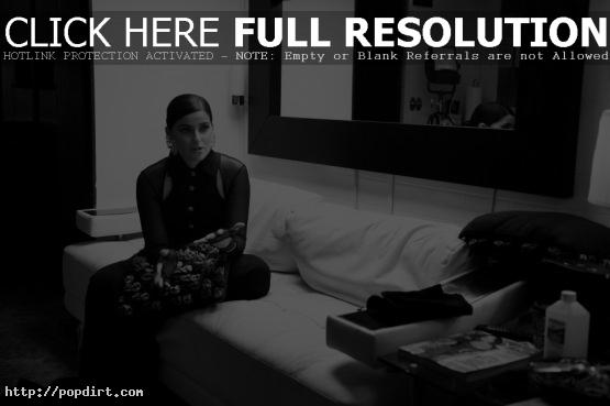 Nelly Furtado on the couch during her 'Big Hoops (The Bigger The Better)' music video shoot