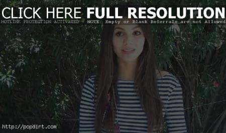 Victoria Justice, seen here in stripes, is among the pop artists reacting to the news of a tragic killing spree at Sandy Hook Elementary School
